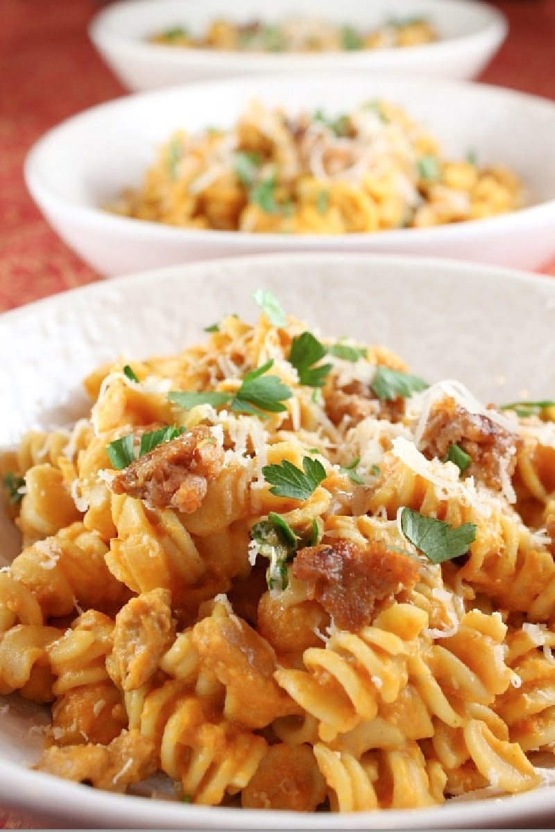 creamy pumpkin pasta with sausage in a bowl