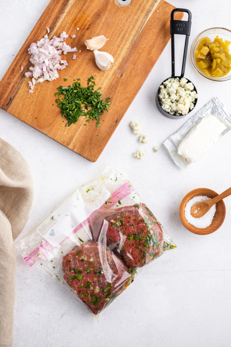 steaks marinating in a baggie