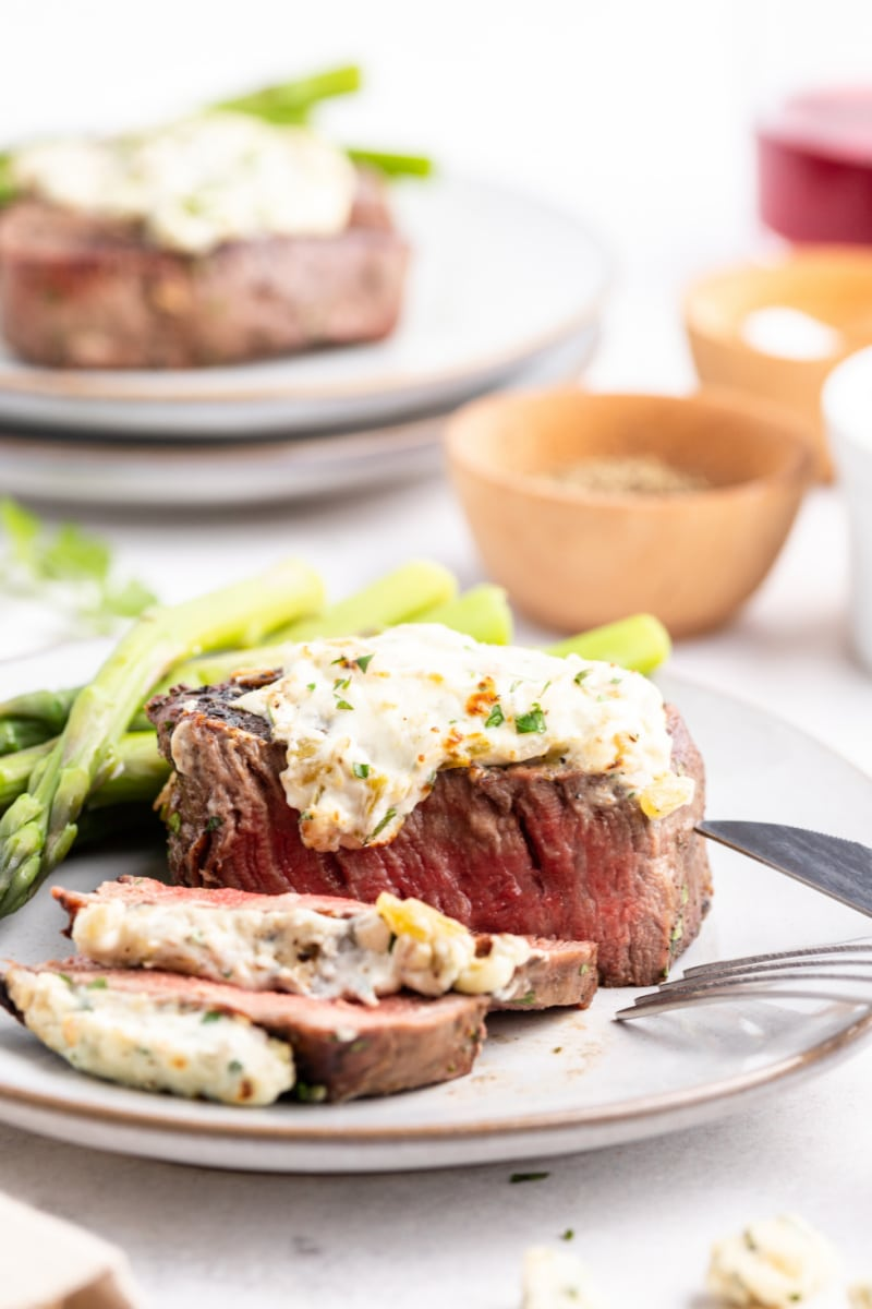 steak on plate topped with blue cheese sauce