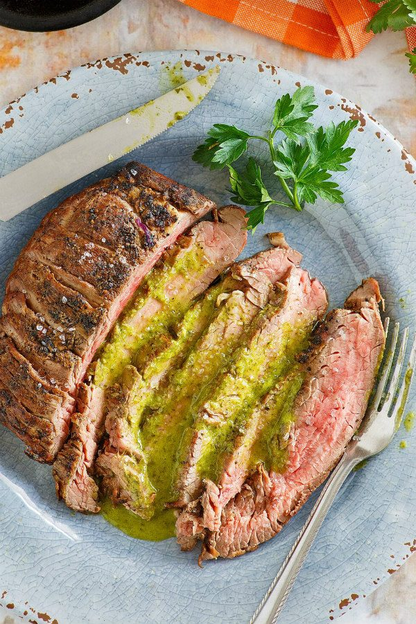 Marinated Flank Steak with Cilantro Parsley Vinaigrette sliced