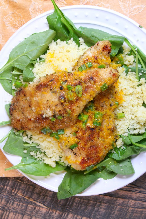 Orange Scallion Chicken on a bed of spinach and couscous