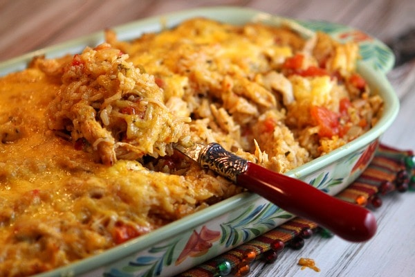 tex mex chicken and rice casserole in a casserole dish with a spoon