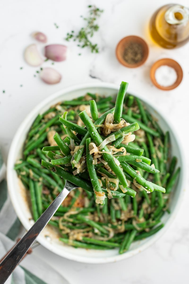 bowl of green beans with caramelized shallots