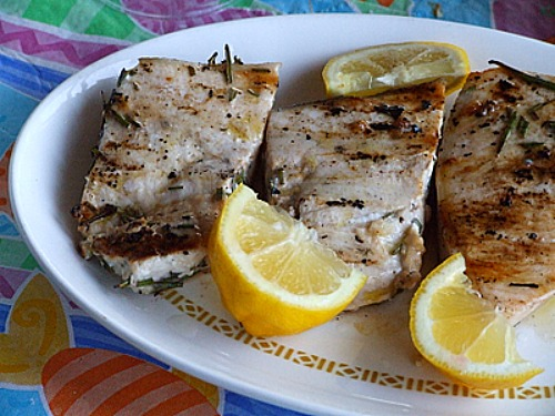 grilled swordfish with rosemary and lemon wedges
