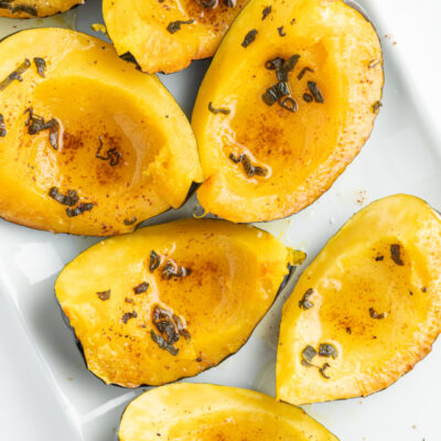 roasted winter squash wedges on a platter