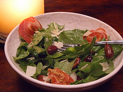 Arugula Salad with Olives, Pancetta and Parmesan Shavings recipe from RecipeGIrl.com