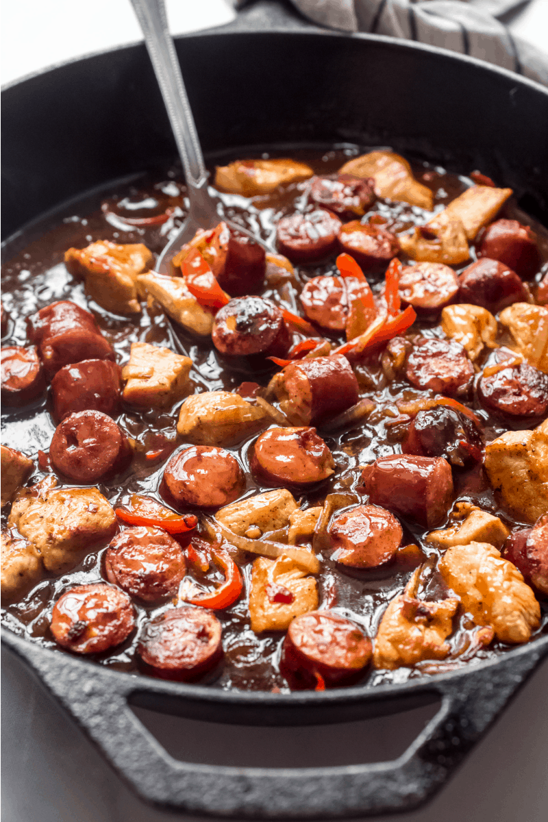 chicken and sausage mixture in a pan with sauce