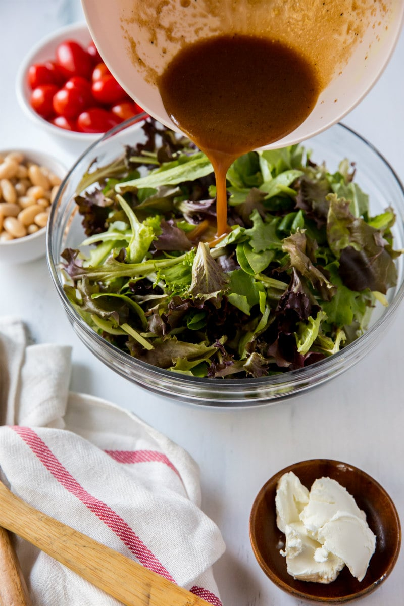 adding dressing to five minute salad