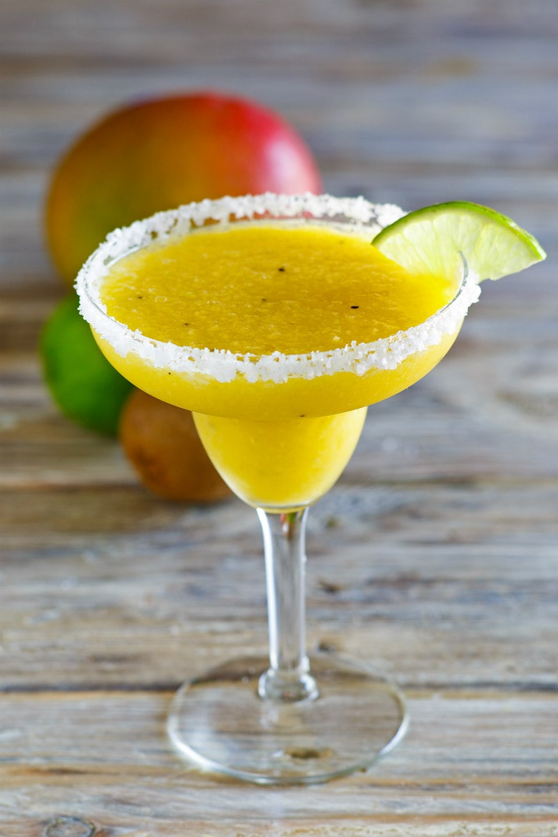 Tropical Margaritas in a margarita glass with lime wedge