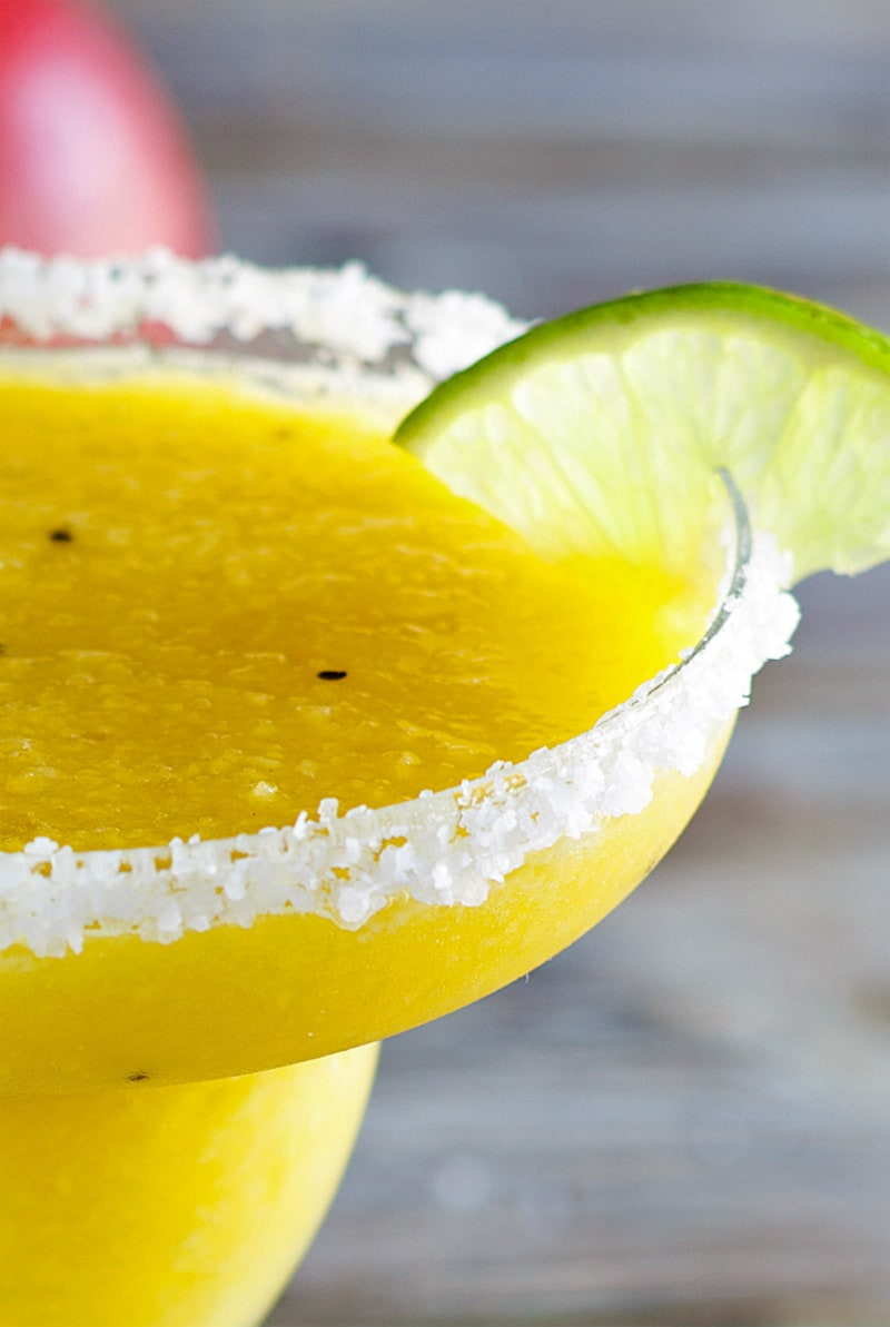 close up of tropical margarita with lime wedge
