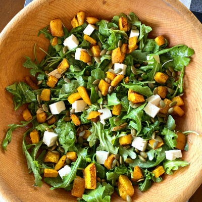 maple roasted pumpkin salad in a wooden bowl