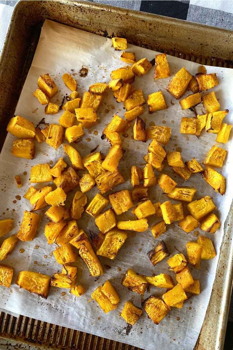 roasted pumpkin chunks on baking sheet