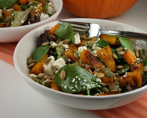 maple roasted pumpkin salad in a white bowl