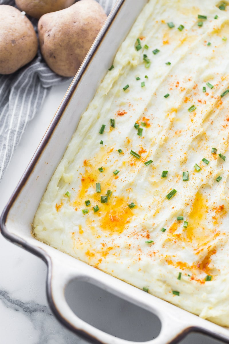 Creamy Oven Baked Mashed Potatoes in a Casserole Dish