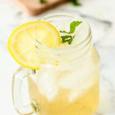 vodka lemonade in a glass mug garnished with lemon
