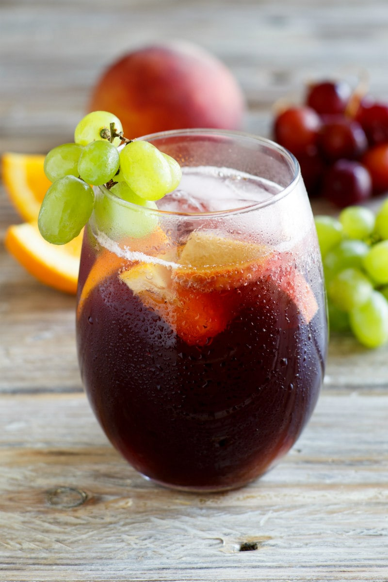Glass of Grape Sangria garnished with green grapes