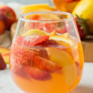 glass of strawberry peach sangria