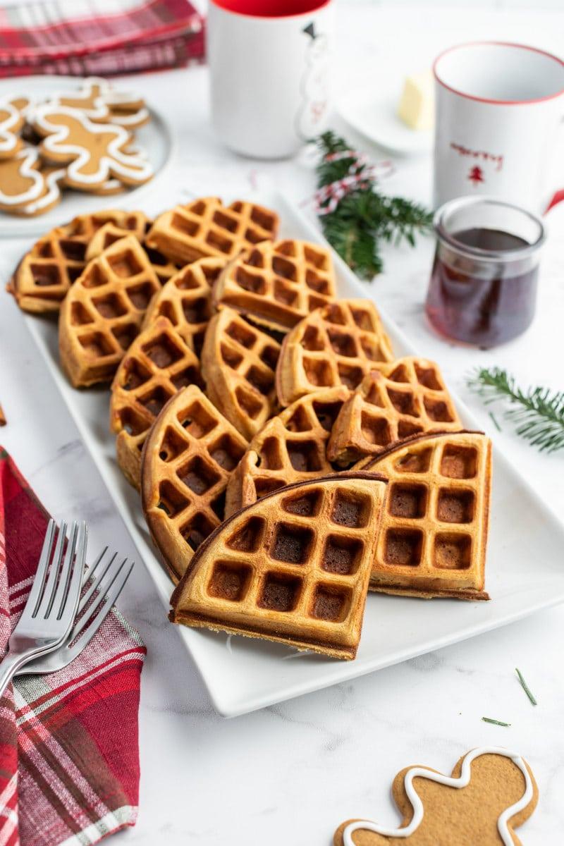 gingerbread waffles broken up into wedges displayed on white platter