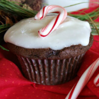 chocolate cupcakes with peppermint icing and a candy cane on top