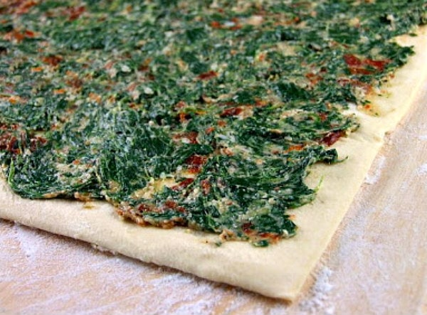 puff pastry with spinach and sundried tomato spread on top