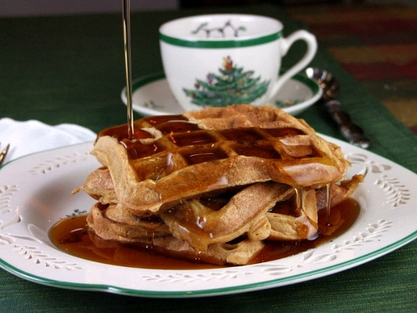 gingerbread waffles on christmas china with syrup