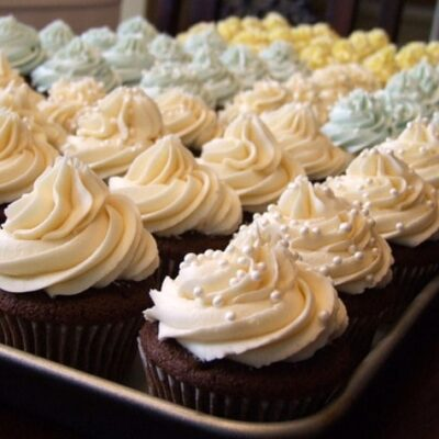 tray full of wedding cake cupcakes
