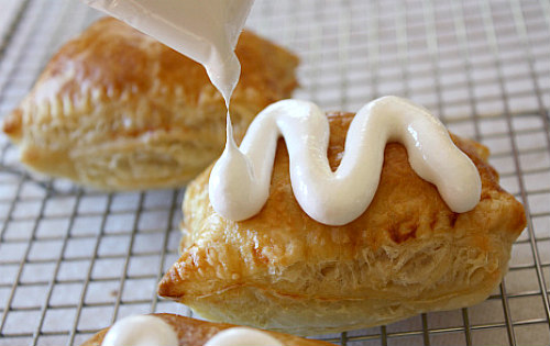 Peanut Butter S'Mores Turnovers drizzled with melted marshmallow