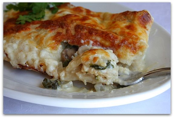 Creamy Chicken, Spinach and Mushroom Enchiladas - recipe from RecipeGirl.com