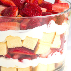 layered strawberry trifle in a glass trifle dish