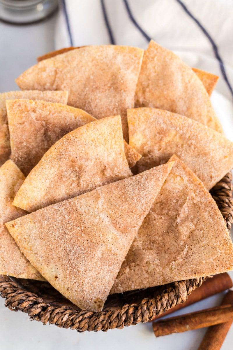 cinnamon bunuelos in a basket