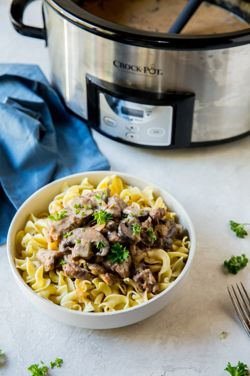 Best Slow Cooker Beef Stroganoff Recipe - This lightened- up Slow Cooker Beef Stroganoff is super simple to make. Let your slow cooker do the work for you and dinner will be done in 6 hours!