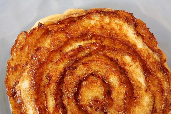 Close up of Cinnamon Roll Pancakes before adding glaze