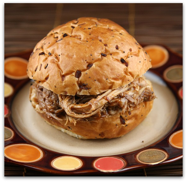 Serve a good scoopful of pulled pork on a warmed bun. We like ours ...