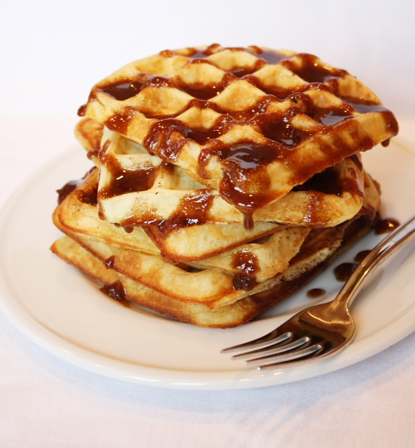 stack of waffles with cinnamon topping