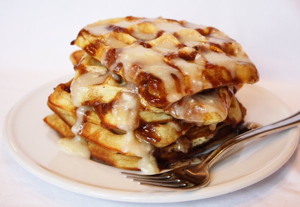 stack of Cinnamon Roll Waffles with Cream Cheese Glaze
