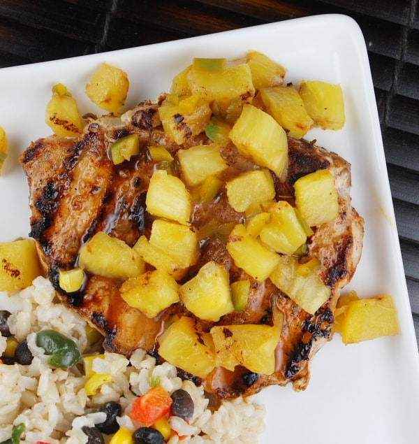 Chili Rubbed Pork Chops with Grilled Pineapple Salsa recipe from RecipeGirl.com