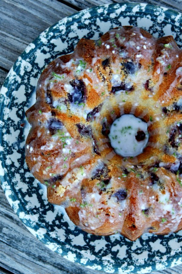 Cherry Limeade Pound Cake made from a bundt pan displayed on a blue and white patterned cake platter