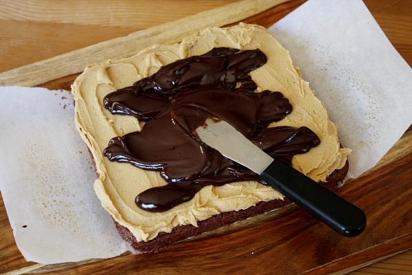 spreading ganache on top of brownies