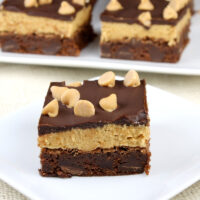 peanut butter cookie dough brownie on white plate with more in the background