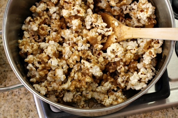 How to Make Caramel Corn : stir the caramel into the popcorn