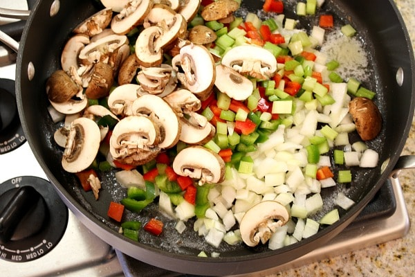 sauteing vegetables in a skillet to make chicken spaghetti casserole