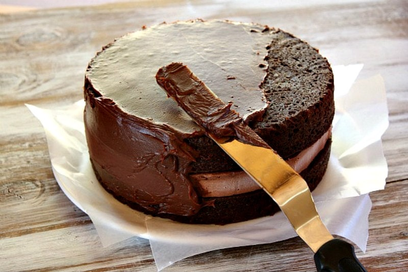 frosting a Chocolate Cheesecake Cake