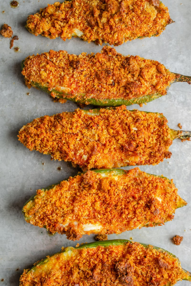 baked jalapeno poppers on baking sheet