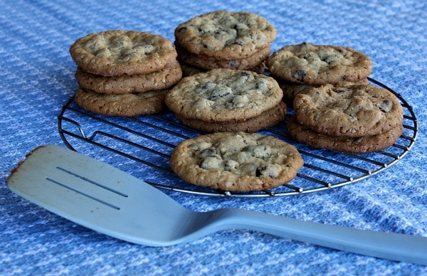cookies piled on a cooling  rack