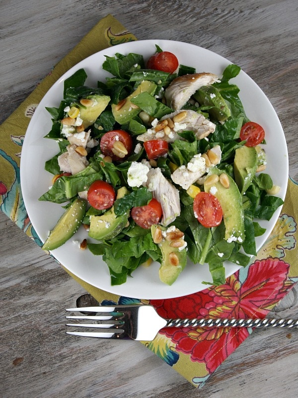 Spinach salad with chicken avocado and goat cheese