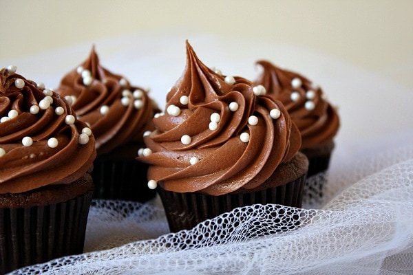 You can always set the baked cupcakes inside of a more decorative wrapper on