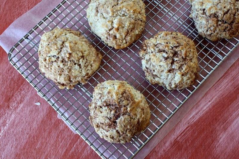 cinnamon bun scones cooling on a rack
