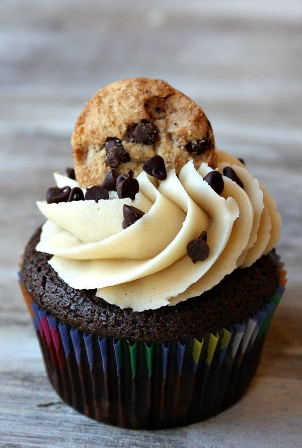 Chocolate Chip Cookie Dough Cupcakes garnished with a chocolate chip cookie