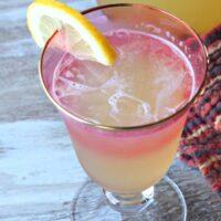 ginger beer lemonade in a glass garnished with lemon