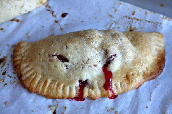 Baked Berry Hand Pie on a baking sheet lined with parchment paper